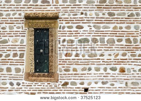 Small window on ancient wall