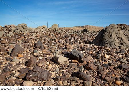 Volcanic Rock And Sediments In A Dried-up Riverbed In Oman