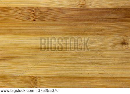 Texture Of Wooden Board Made Of Bamboo. Background Photo Of Texture Of Wooden Chopping Board Made Of