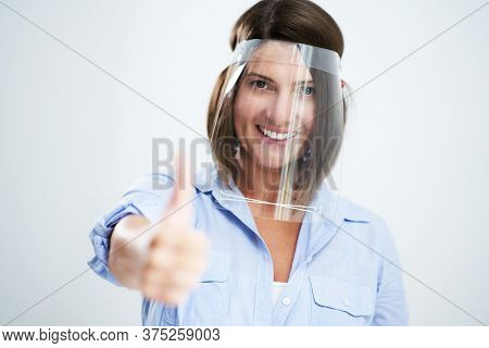 Attractive woman wearing protective shield isolated over white background