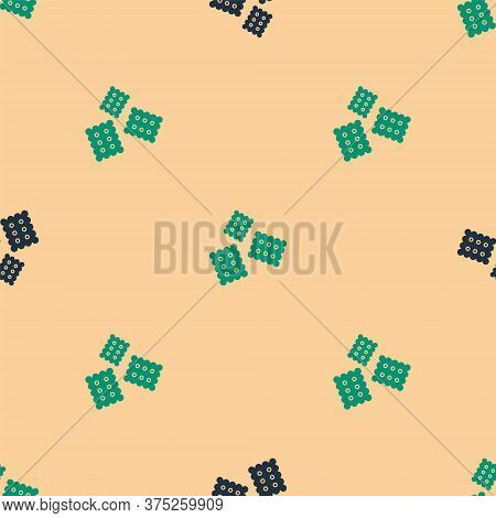 Green And Black Cracker Biscuit Icon Isolated Seamless Pattern On Beige Background. Sweet Cookie. Ve