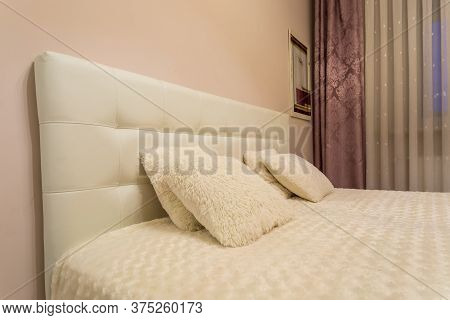 Minsk, Belarus -  June 2020: Double Bed With Pillows In Interior Of The Modern Intimate Bedroom In F