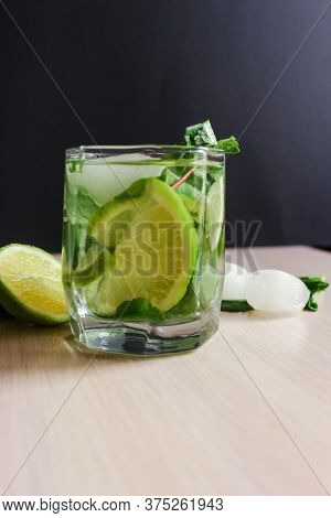 Refreshing Mint Cocktail Mojito With Rum And Lime, Cold Drink Or Beverage With Ice On Black Backgrou