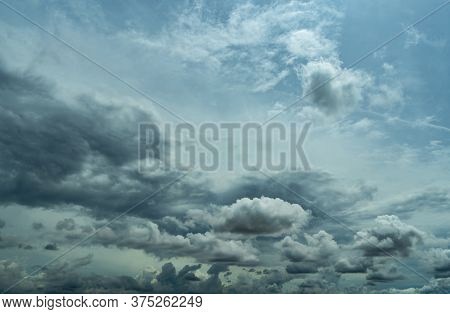 Blue Sky And Dark Cumulus Clouds. Cloudscape. Blue Sky And Fluffy Clouds. The Storm Sky Before Raini