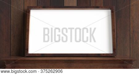 Photo Frame On A Shelf, Wooden Wall Background. Picture Frame Blank Empty White, Template For Painti