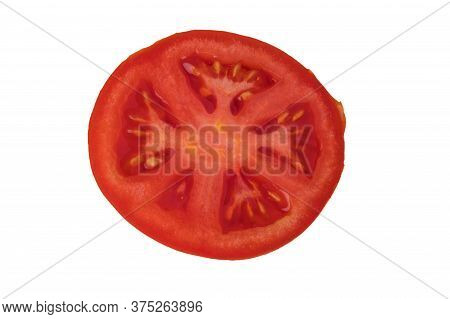 Whole And Cut Red Tomatoes, Sliced, Sliced On A White Plate In Isolation