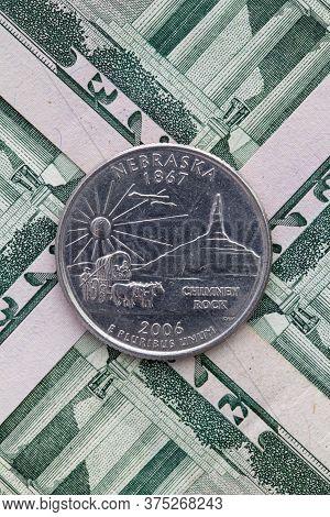 A Quarter Of Nebraska On Us Dollar Bills. Symmetric Composition Of Us Dollar Bills And A Quarter Of
