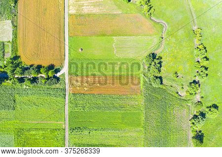 Above View Of Rural Summer Scene: Fields, Road And Small Brook