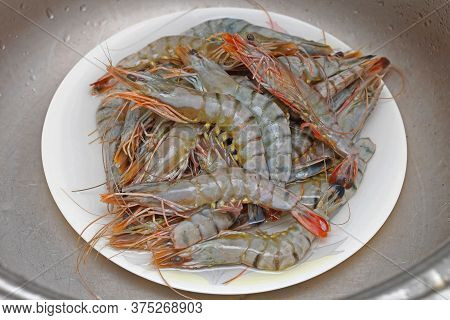 Bunch Of Big Tiger Prawns Seafood Crustaceans At Plate