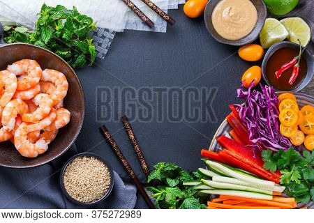 Spring Or Summer Rolls Preparation With Rice Paper, Carrot, Chili Sauce, Red Cabbage, Zucchini , Pep