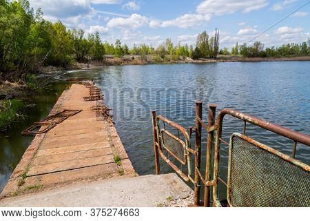 Lake in the town of Prypjat in Ukraine. Lake full of hazardous radioactive waste. after the nuclear disaster of Chernobyl
