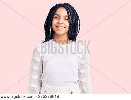 Cute african american girl wearing casual white tshirt with a happy and cool smile on face. lucky person.