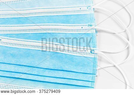 Close-up Of Some Surgical Masks Isolated On White Background