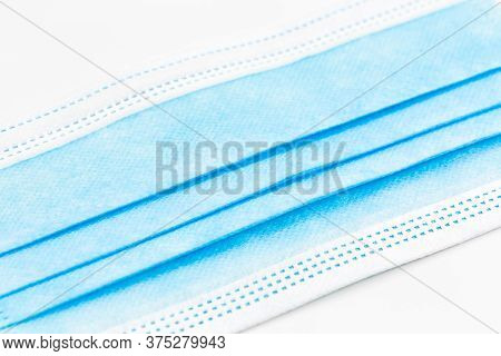 Close-up Of A Single Surgical Masks Isolated On White Background