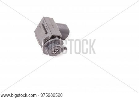 Close-up Of A Spare Part For An Air Quality Sensor Car For Replacement During Repair Or For Sale At
