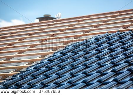 Black Roof Of Burnt Tiles Under The Construction, Roof Paver