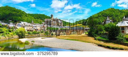 Estaing- beautiful village of France in Aveyron- touristic historic village with castle, river and bridge