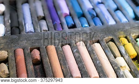 Multi-colored Pastel Crayons. Materials For Drawing And Creativity. Bright Water-based Paints. Schoo