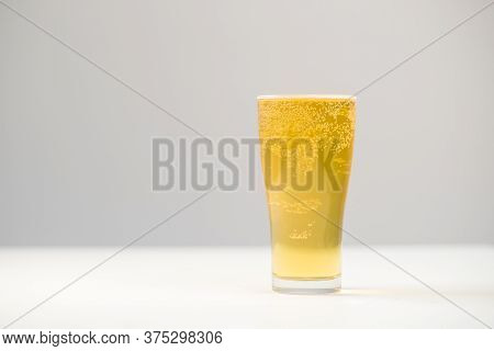 Beer In Pint Glass On White Background