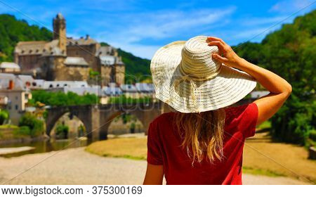 woman tourist in France, beautiful village in Aveyron- Estaing