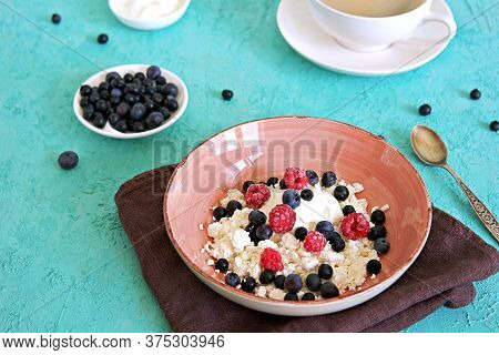 Breakfast, Fresh Organic Farm Cottage Cheese With Sour Cream And Berries, Fresh Blueberries And Froz