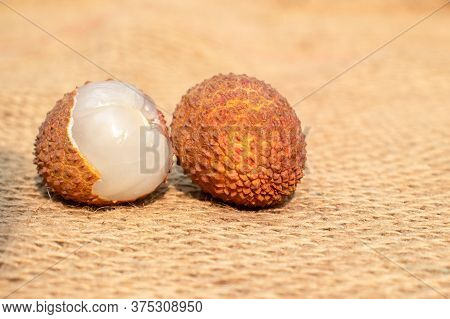 Closeup Of  Lychee Or Litchi Fruit On Burlap Background