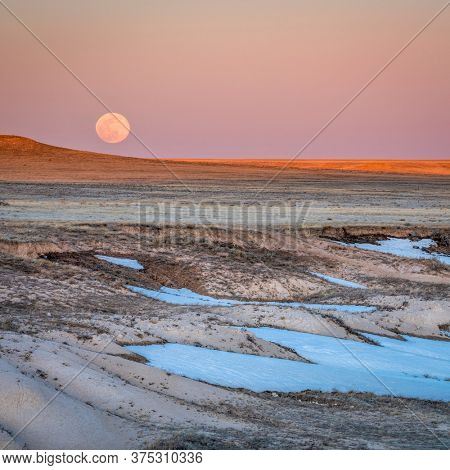 Sunset and moon rise over prairie - Pawnee National Grassland in northern Colorado in early spring scenery