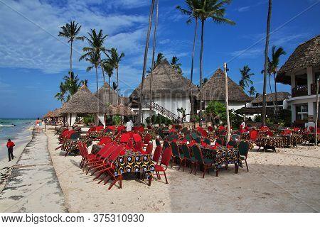 Zanzibar / Tanzania - 31 Dec 2016: Palms On Nungwi Beach Of Zanzibar, Tanzania