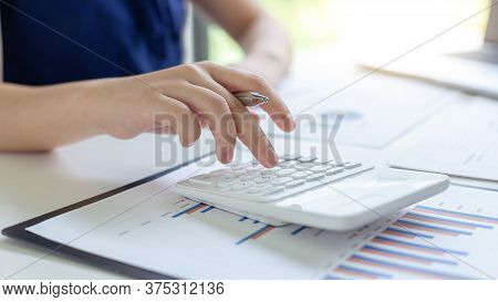 Accounting businessmen are calculating income-expenditure and analyzing real estate investment data,