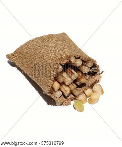 Lotus Rhizome Or Roots Vegetable In Jute Sack Isolated On White Background