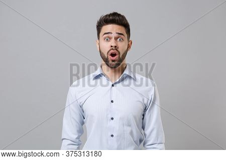 Shocked Amazed Young Unshaven Business Man In Light Shirt Posing Isolated On Grey Wall Background St