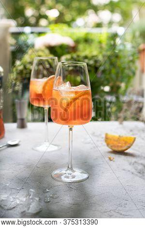 Summer Refreshing Aperol Spritz Cocktail In Wine Glass