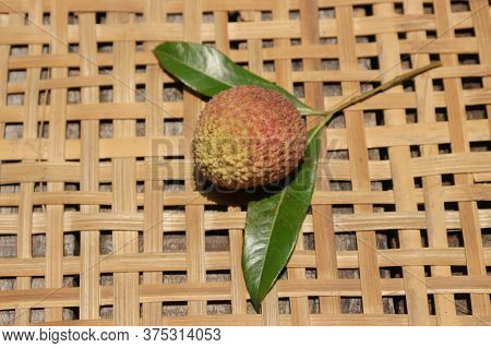 Closeup Of Organic Litchi Or Lychee With Leaves