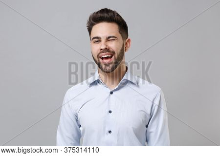 Cheerful Funny Young Unshaven Business Man In Light Shirt Posing Isolated On Grey Background Studio