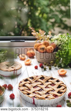 Homemade Cooking Bakery, Summer Berry Pie With Raspberry And Apricots, Rustic Wooden Table