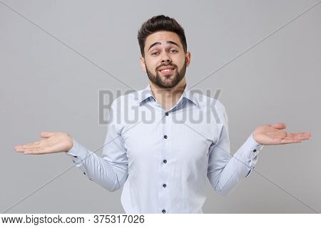 Perplexed Bewildered Young Unshaven Business Man In Light Shirt Posing Isolated On Grey Background S