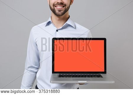 Cropped Image Of Young Unshaven Business Man In Light Shirt Isolated On Grey Background. Achievement
