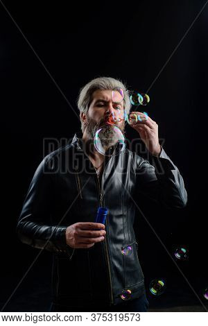 Man Blowing Bubbles. Soap Bubbles. Man Play With Bubbles. Bearded Man Blowing Soap Bubbles. Happines