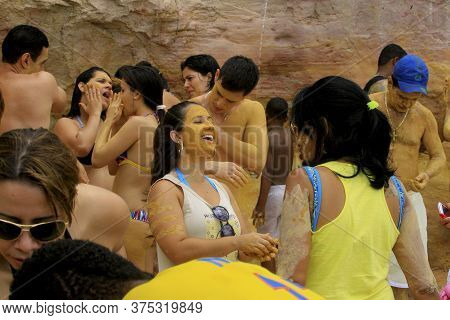 Cairu, Bahia / Brazil - November 14, 2013:  Tourists Bathe With Clay With Medicinal Properties On Ga