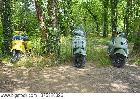 Villaggio Di Punta Sdobba, Italy - June 14 2020. Three Vintage Vespas, Part Of A Small Rally Of Vesp
