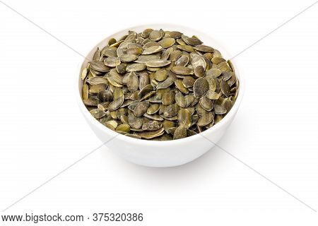 Bowl With Pumpkin Seeds Isolated On White Background