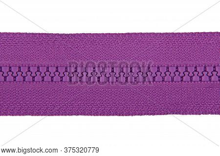 Closed Purple Zipper Isolated On White Background. Purple Zipper For Tailor Sewing.