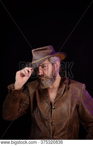 Cowboy Couture. Portrait Of Bearded Man Wearing Cowboy Hat. Western Style Men Fashion. Handsome Cowb