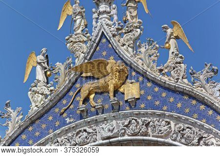 Venice, Italy - July 08, 2013: Golden Lion Of Venice And Winged Angels At Saint Mark Church In Venic