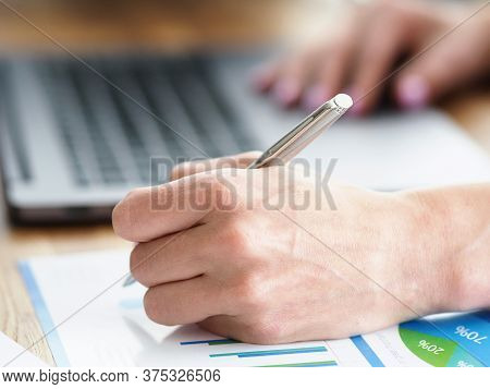 Man At Home Makes Notes In Report Near Laptop. Advising Specialist In Personnel Matters. Services Fo