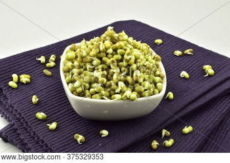 Sprouted Mung In Bowl On Place Mat Isolated On White Background, Mung Sprouts