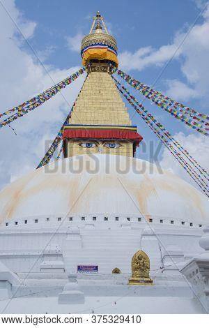 Kathmandu, Nepal - Oct 02, 2017: The Eyes Of The Boudhanath Stupa Is A Holy Buddhist And Hindu Templ