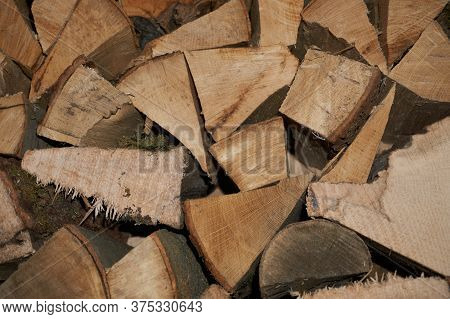 Chopped Wood Laid In A Woodpile To Dry For The Winter. Wood Texture.