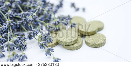 The Concept Of Pills For Treatment. Multi-colored Pills On A White Isolate. Hope For Cure, Hope For