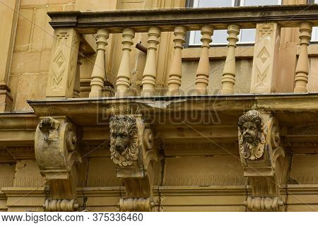 Fragment Of A Balcony Decorated With Balusters, Animal Faces. Stuttgart. Germany. April. 2019